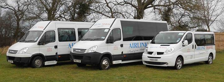 three mini buses